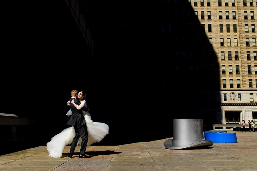 Groom spins bride in Philadelphia Park.