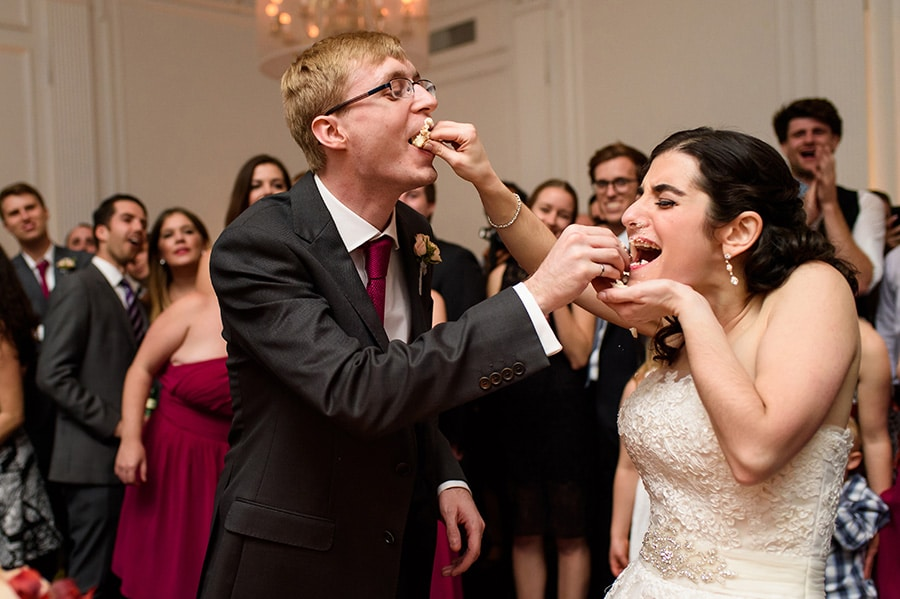 Bride and groom shove cake into each other's face!