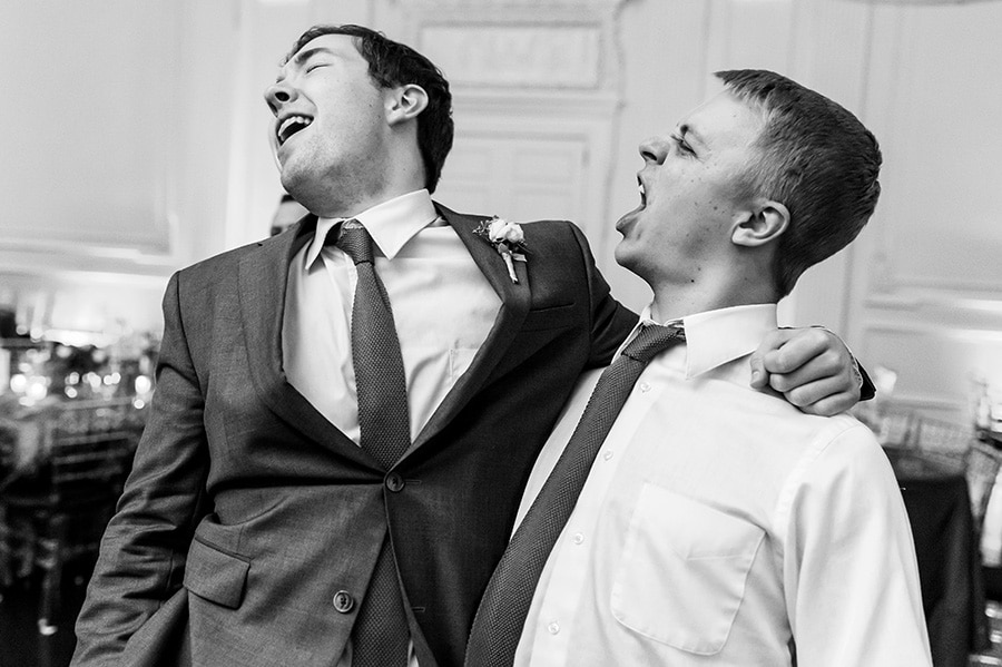 Best man and groomsmen sing along during wedding reception.