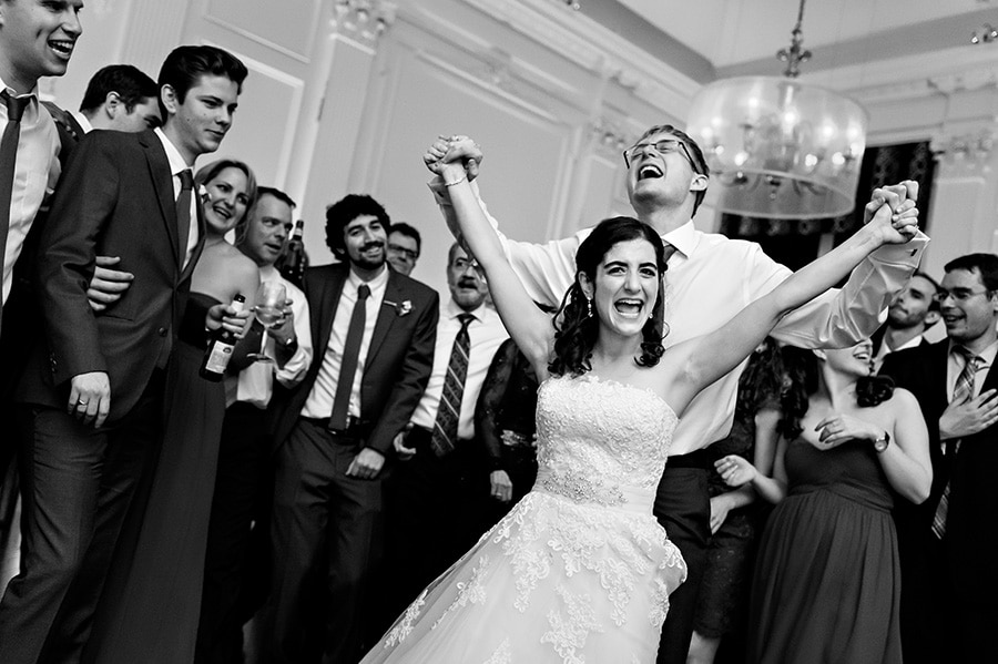 Groom holds brides hands in the air as they sing the last song!
