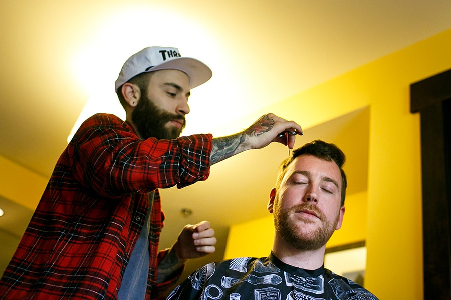Groom having is hair cut on his wedding morning at Bear Creek Mountain Resort.