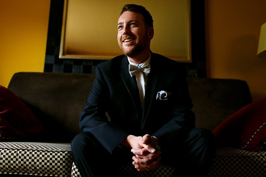 Groom smiles as he sits and waits for ceremony at Bear Creek Mountain Resort in Macungie, PA.