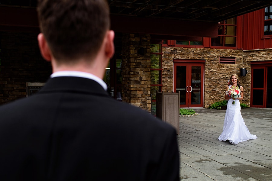 Bride walks to tearful groom during their wedding ceremony at Bear Creek Mountain Resort.