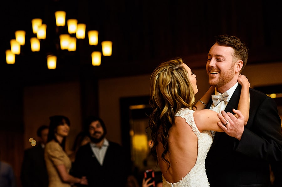 Groom smiles at bride during the first dance of their wedding reception at Bear Creek Mountain Resort.