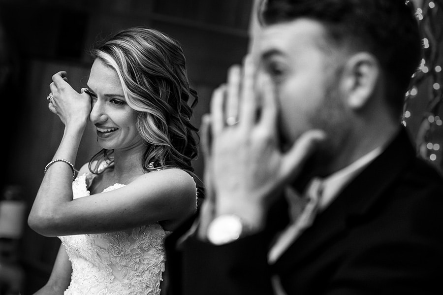 Bride and groom wipe tears from their eyes during wedding speech!