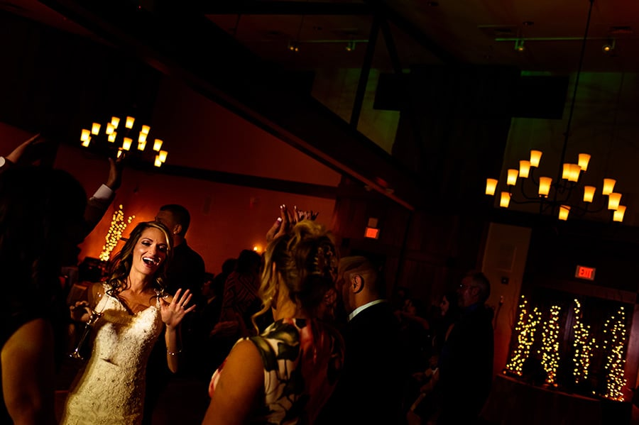 Bride dances with friend sat wedding reception at Bear Creek Mountain Resort.