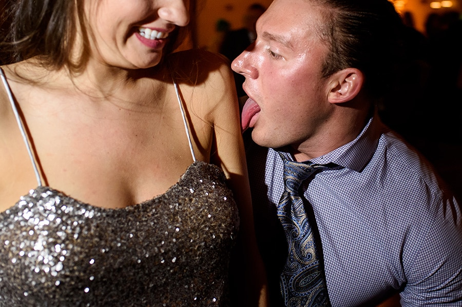 Guy licks bridesmaid's arm on dance floor during wedding reception at Bear Creek Mountain Resort in Macungie, PA.