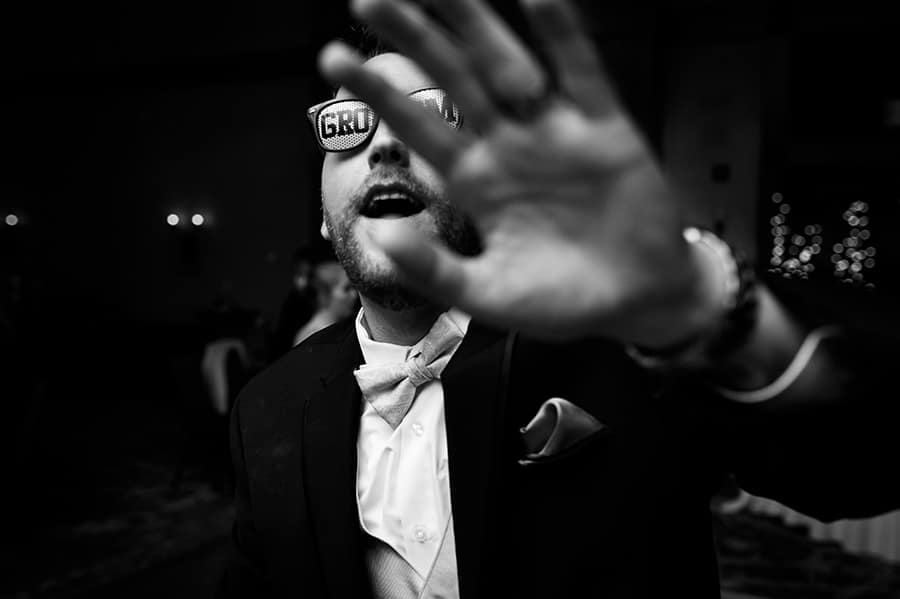 "Groom wears sunglasses that say ""groom"" on them during wedding reception!"