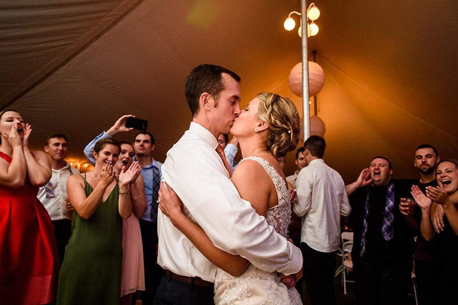 Bride and groom kiss at the end of their wedding reception in New Jersey.