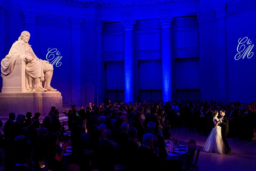 Bride and groom share their first dance in the Franklin Institute.